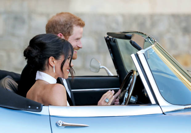 The Duke and Duchess of Sussex drove to theirwedding reception inan electric-poweredJaguar E-Type Zero, about £850,000