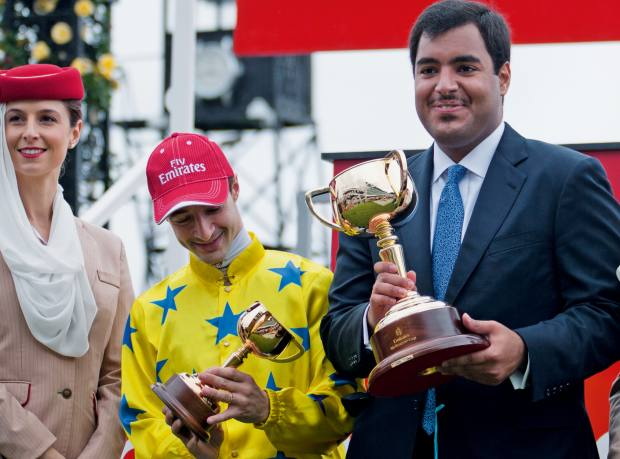 Jockey Christophe Lemaire and horse owner Sheikh Fahad receive the Melbourne Cup in 2011