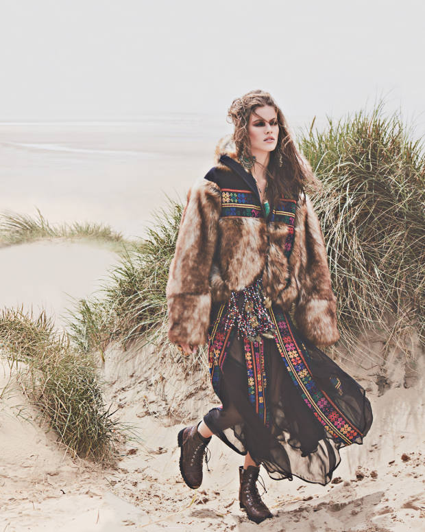 Sacai wool and faux-fur jacket, £970, and cotton skirt, £1,463. Giuseppe Zanotti leather Thora boots,£805.Pebble Londonbrass,leather andglass-beadtribal bag, £750, Afghansilver and glass‑beadearrings, £145, inlaid-gold, malachite and glass-bead tusk necklace, £145, and gold-plate and stone rings, from £55