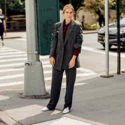 Gaia Repossi wears a Bottega Veneta jacket, trousers, bag and shoes