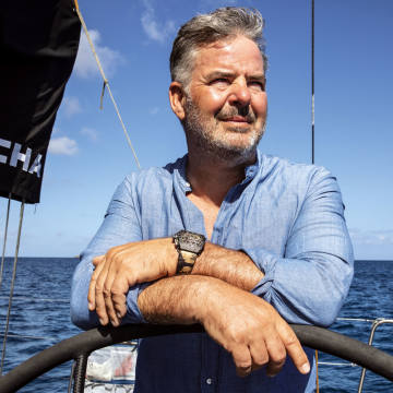 Peter Harrison at the helm of Sorcha, his Maxi 72 racing yacht