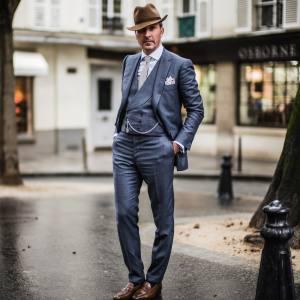 Alexander Kraft wears Cifonelli bespoke three-piece suit, Rubinacci hat, Drake's tie and Rolex pocket watch