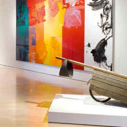 The Hess Art Collection Museum houses works by Dutch artist Armando (far left) and Robert Rauschenberg (from right, Empire I, 1961, Tabernacle Fuss, 1992, Untitled from the Urban Bourbon series, 1973, Intermission, 1996).