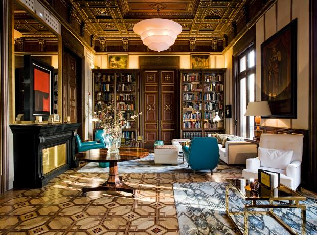 The library at the Cotton House, Barcelona, which serves traditional English afternoon teas