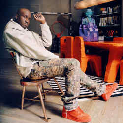 Virgil Abloh photographed in his Paris studio, sitting on the bronze Alaska chair from his 2019 Acqua Alta collection