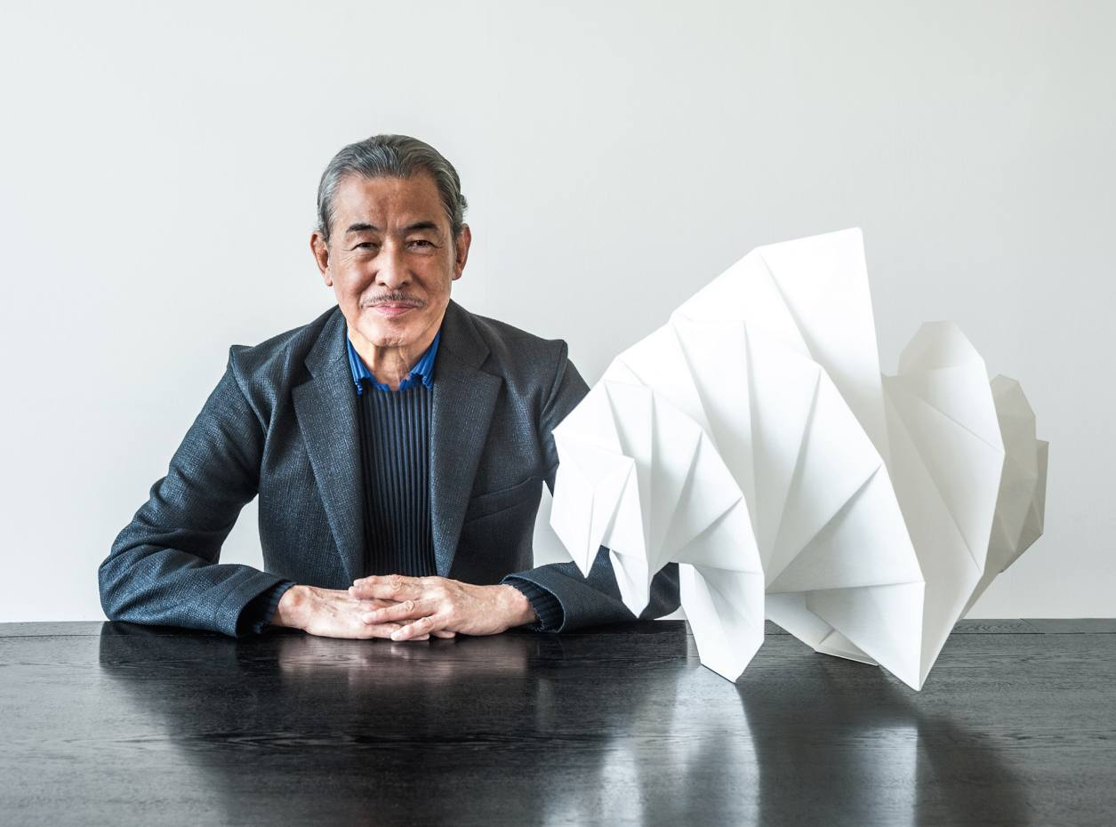 Issey Miyake with his IN-EI Mendori light, £635, at the Issey Miyake Inc headquarters in Tokyo