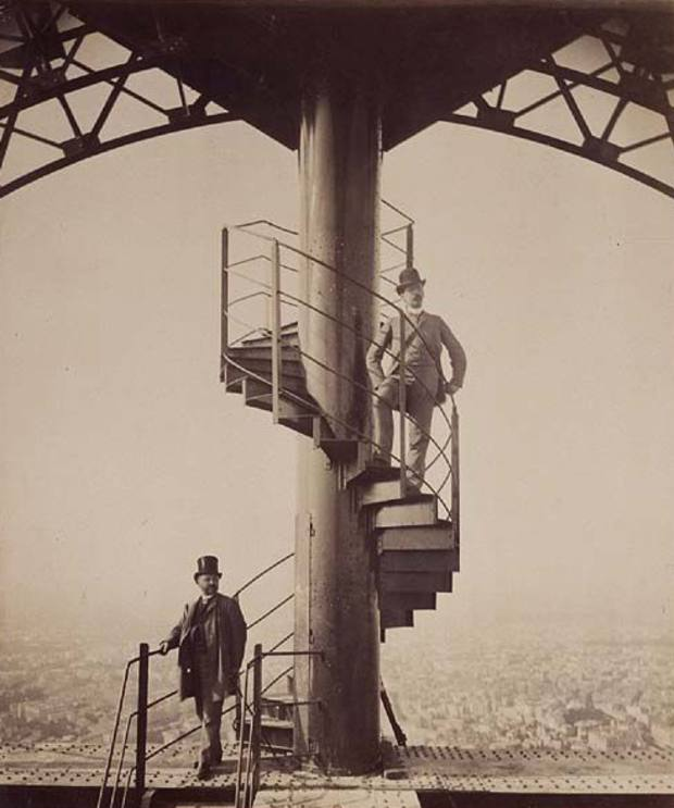 Gustave Eiffel pictured on the spiral staircase (at bottom of stairs), 1889