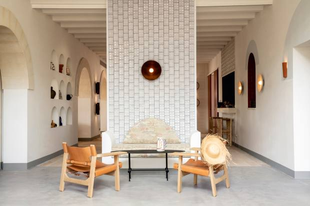 The hotel interiors by Dorothée Meilichzon incorporate traditional Menorcan elements, seen in the lobby