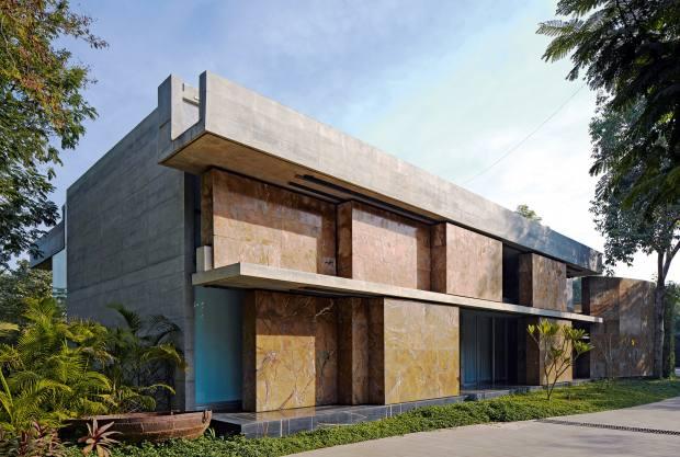 The India-based Moving Landscape House haspivoting stone doors
