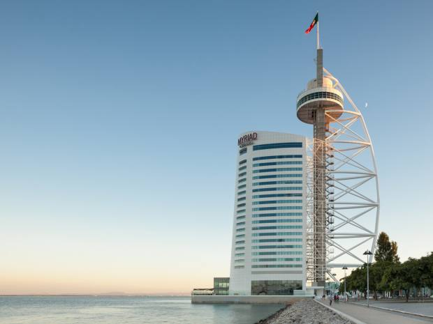 The Vasco da Gama Tower sits next to the River Tagus