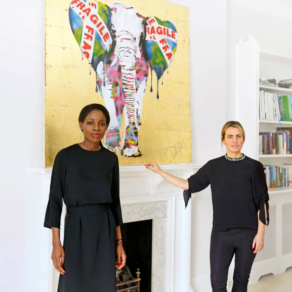 Joy Abiola, left, and Gabrielle du Plooy at Abiola's London home, with The Fragile World, bought for £8,000