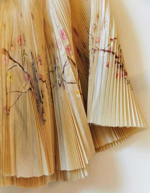 Simmons' Alexander McQueen hand-painted, pleated silk skirt
