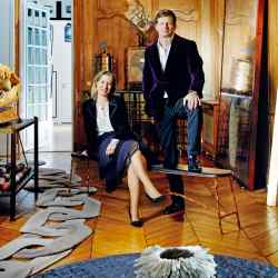 Collector Lorenz Bäumer and gallerist Marie-Bérangère Gosserez at his Paris apartment with charred-oak and coppered-steel Spring/Summer bench by Valentin Loellmann and (far right) titanium, tissue-paper and acrylic Oblique Cassée light sculpture by Valérie Jolly