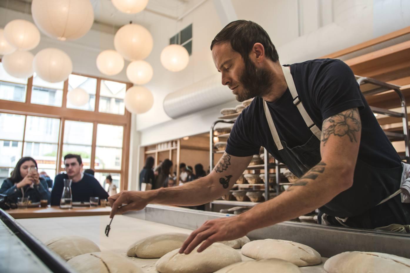 Co-founder Chad Robertson scores bread dough