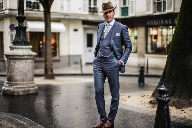Alexander Kraft wears Cifonelli bespoke three-piece suit, Rubinacci hat, Drake's tie and Rolex pocket watch