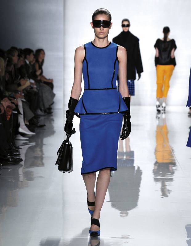 Felted jersey peplum sheath dress, £1,070, plastic Teri goggles, £130, leather gloves, £460, leather Carrington satchel, £960, and Amador Runway shoes, £345. All Michael Kors autumn/winter 2013