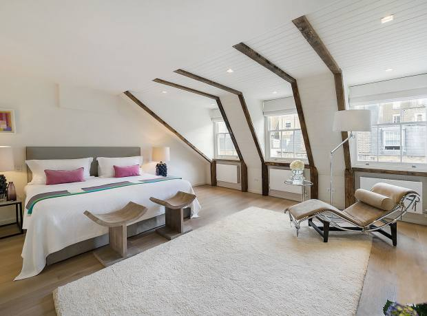 One of the bedrooms of a four-bedroom house in Queen's Gate Place Mews, Chelsea, £6.95m through Strutt & Parker and Hamptons International