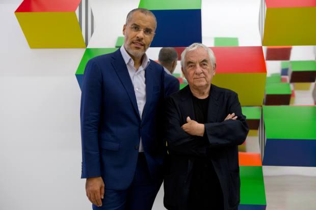 Kamel Mennour and the artist Daniel Buren