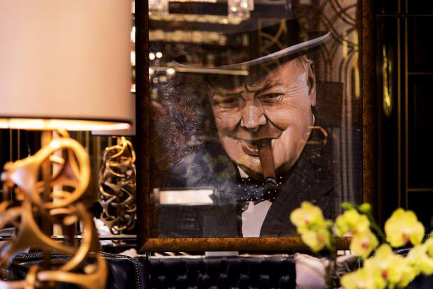 A portrait of famous cigar smoker Winston Churchill in the humidor room at the Wellesley hotel in Knightsbridge
