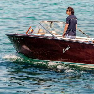 One of Genevaboats' knowledgeable pilots, Dimitri Cogne, skippering a Boesch Costa Brava motorboat