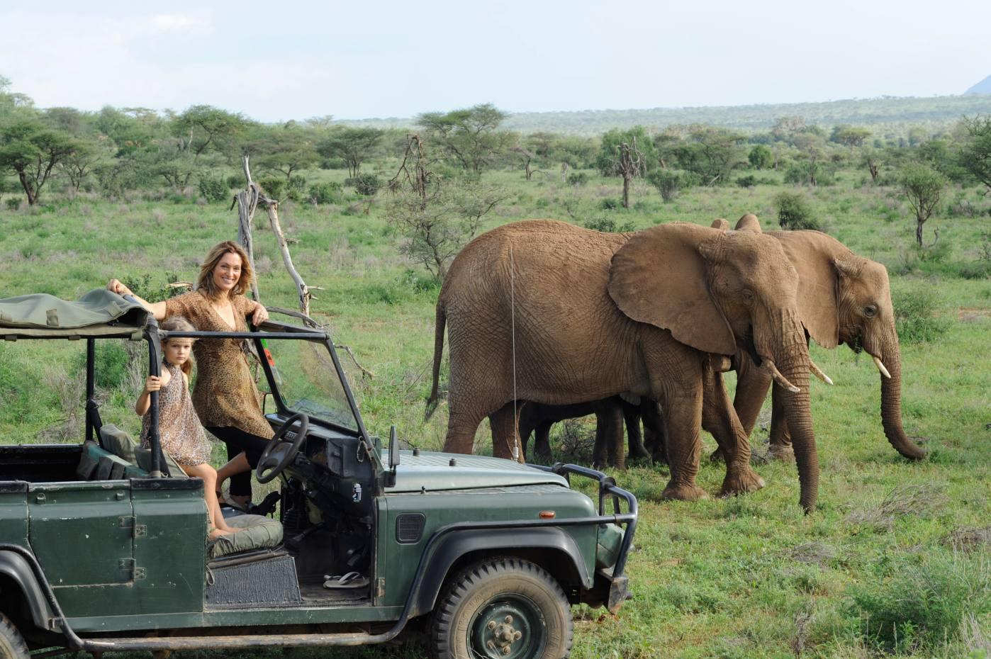 Conservationist Saba Douglas-Hamilton watching elephants in Samburu National Reserve with her daughter