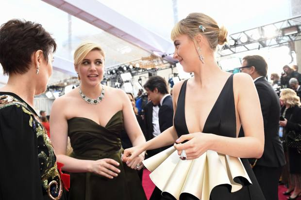Greta Gerwig wearing Bulgari jewellery and Saoirse Ronan in Gucci at the 2020 Oscars