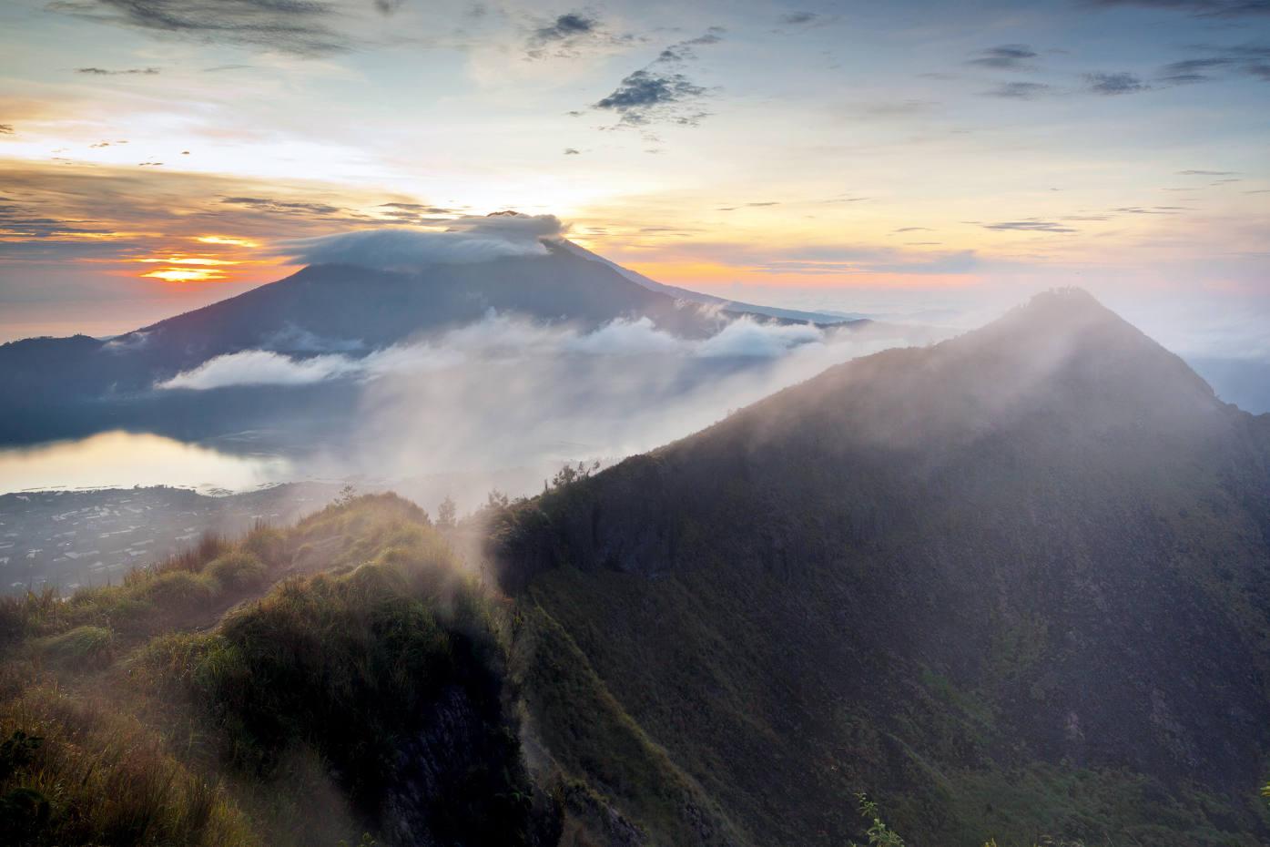 Batur Volcano rises above Lake Batur