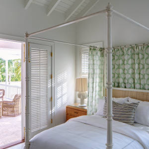 A cottage bedroom at Bahama House Inn on Harbour Island
