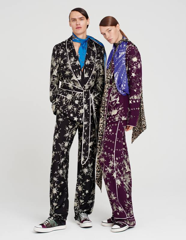He wears Roberto Cavalli silk jacket, £1,360, matching trousers, £710, leather trainers, £430, and silk scarf, £214. She wears Roberto Cavalli silk jacket, £1,415, matching trousers, £720, leather trainers, £430, silk scarf with stars, £162, and silk leopard-print scarf, £149