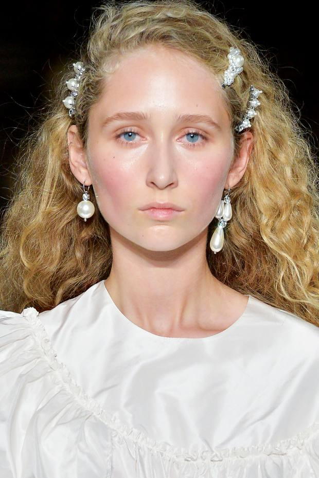 Simone Rocha faux-pearl and diamanté earrings, from £195 each, and matching hair accessories, from £75