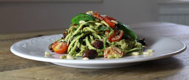 Garlic and basil linguine made of finely julienned courgette tossed in a pine nut pesto