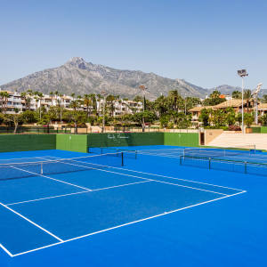The tennis courts at Marbella's five-star Puente Romano resort