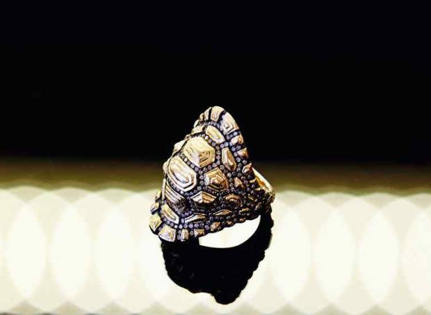 Charlotte Olympia Dellal's gold and diamond Venyx ring