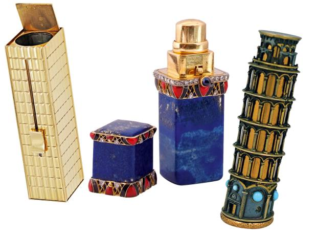 From left: c1950 18ct gold case, $2,500 from Beladora. 1920s Boucheron gold, lapis lazuli, diamond, sapphire and enamel case, £15,000 from Symbolic & Chase. 1950s Stratton silver and gilt metal Leaning Tower of Pisa case, about £645 from 1stdibs