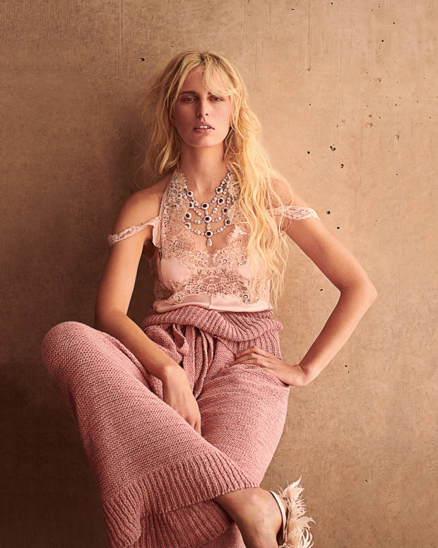 Stella McCartney silk satin Kimberley top, £810, and cotton trousers, £495. Simone Rocha satin and feather sandals, price on request. Boghossian white gold, diamond, ruby and mother‑of-pearl Inlay necklace, price on request