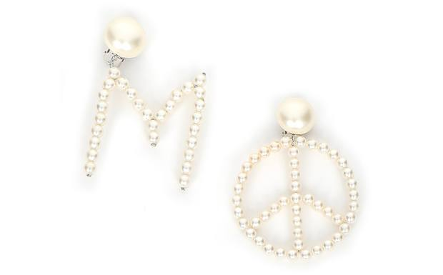 Moschino pearl M earring, £186, and peace earring, £106