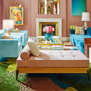 The irreverently joyful lapis‑blue reception room in the Paris apartment of interior designer Géraldine Prieuer is furnished with custom-made cushions, from €295, and rug, from €650, from her studio Rouge Absolu
