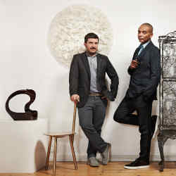Valerio Capo (left) and Sam Pratt, co-directors of Gallery Fumi, with (from left) Enrique Perezalba Red lacquered Chaste stoneware, £4,000, Faye Toogood bronze Spade chair, £14,400, Rowan Mersh dentalium shell Pithvava Female wall installation, £19,000, and Studio Markunpoika steel Engineering Temporality cabinet, £19,000. All from Gallery Fumi