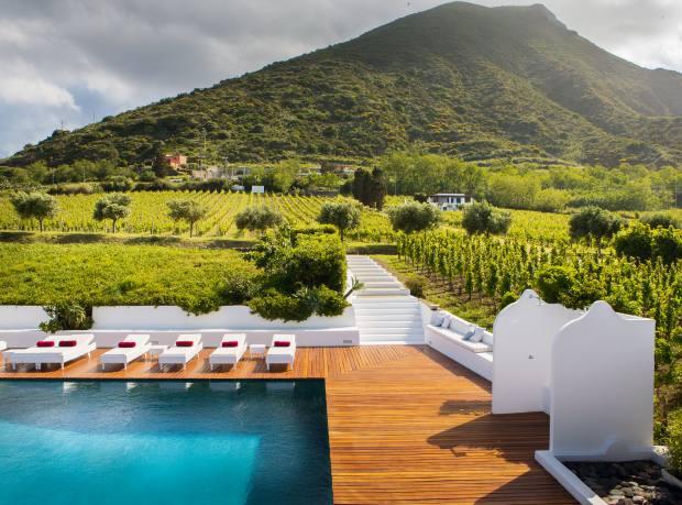The pool at Capofaro resort, set among vineyards on Salina