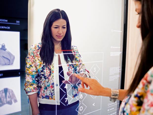 Rebecca Minkoff using an interactive mirror in the Rebecca Minkoff SoHo store, New York