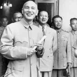 Generalissimo and Madame Chiang Kai-shek speaking to a Moral Rearmament Delegation Taipei in 1955  Picture from the book: The Suit- Function and Style