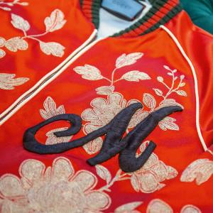 Gucci's bombers and shirts can be emblazoned with snakes, bees or monograms