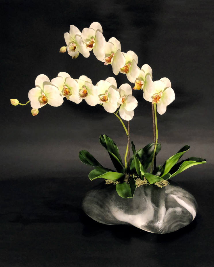 Sebastian Wild Cakes Phalaenopsis orchids and stone cake, £800, commissioned as a table centrepiece for a private dinner in Belgravia