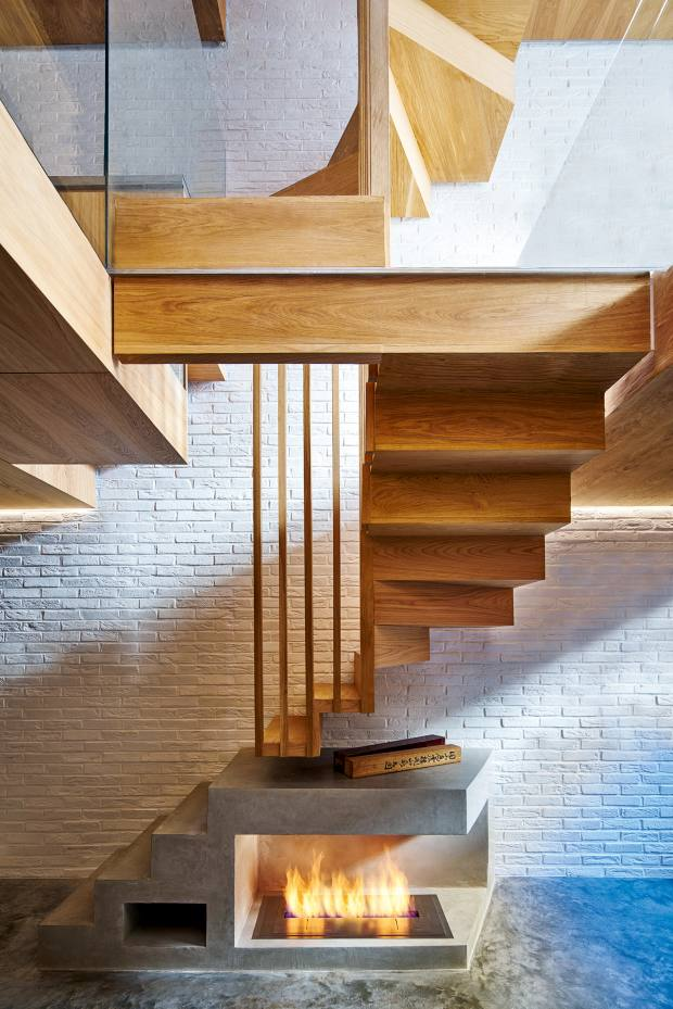 Coffey Architects linked the newly open-plan spaces of this mews house in Lancaster Gate with a dramatic staircase made from white American oak