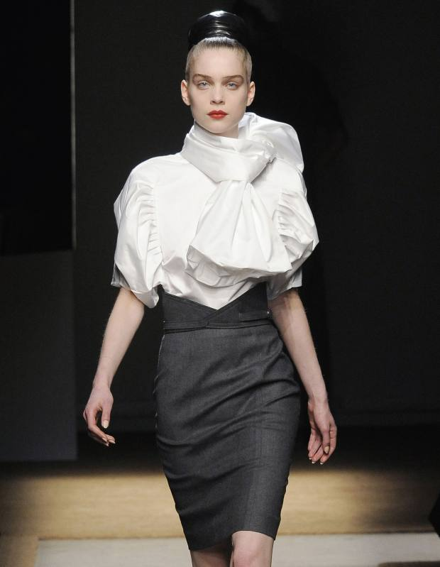 Blouse, £640, scarf, £570, and skirt, £485. YSL autumn/winter.