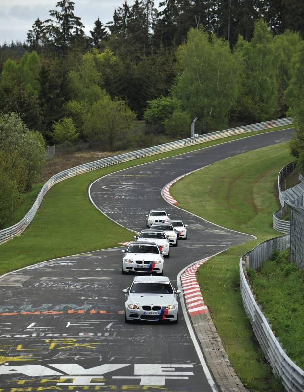 BMW M3 Coupés in high‑speed convoy under instruction on the Nordschleife