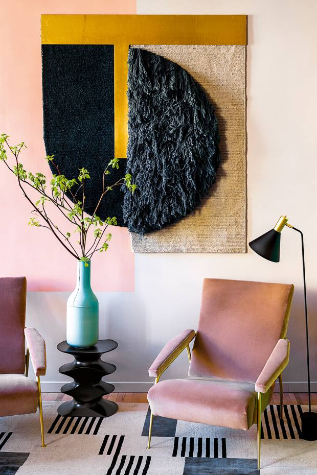 CC-Tapis's Himalayan wool Hello Sonia wall hanging, priceon request, is the focal point of the living room in this Milan apartment by Studiopepe