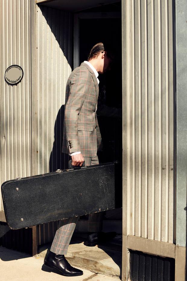 Alexander McQueen wool jacket, £2,345, and matching trousers, £840. Dolce & Gabbana cotton shirt, £525. Berluti leather boots, £1,530.Moscot sunglasses (just seen), £265