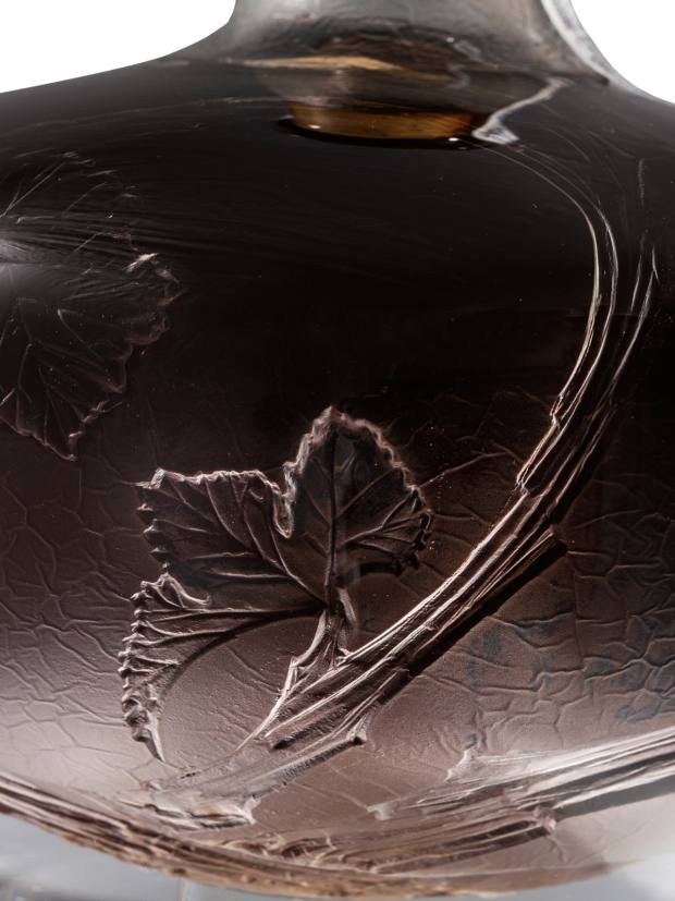 The signed and engraved decanter features delicate detailing