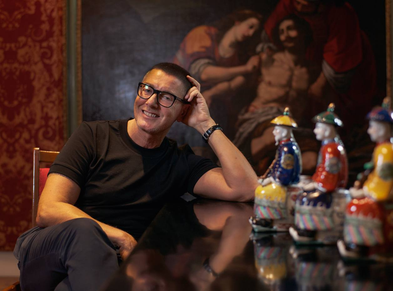 Stefano Gabbana in his apartment in Milan, with his figures of Confucius, Buddha and Lao Tzu